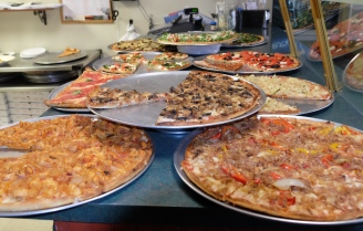 A selection of pizzas available by the slice