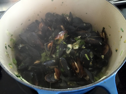 Mussels after cooking in garlic wine sauce