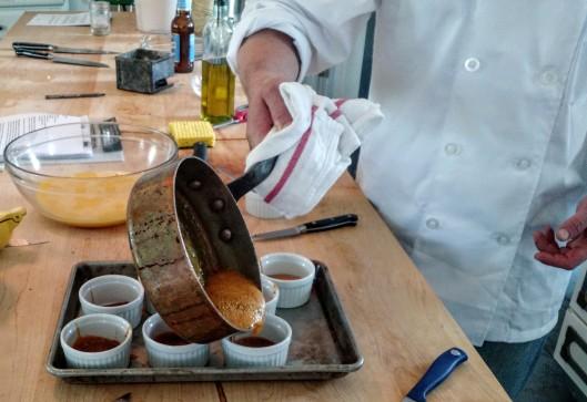 Carefully! pour the molten sugar into the ramekins