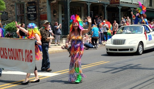 Evy struts by Lambertville House during the Parade. Are we having fun yet?